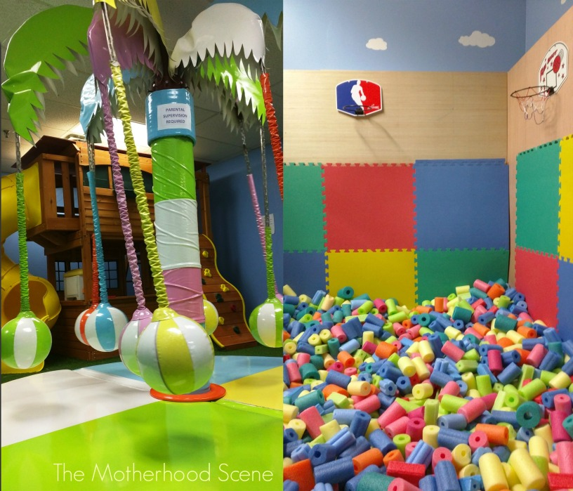 Inside Monkey Business Play Centre there is a motorized revolving tree with hanging balls and a foam pit to play