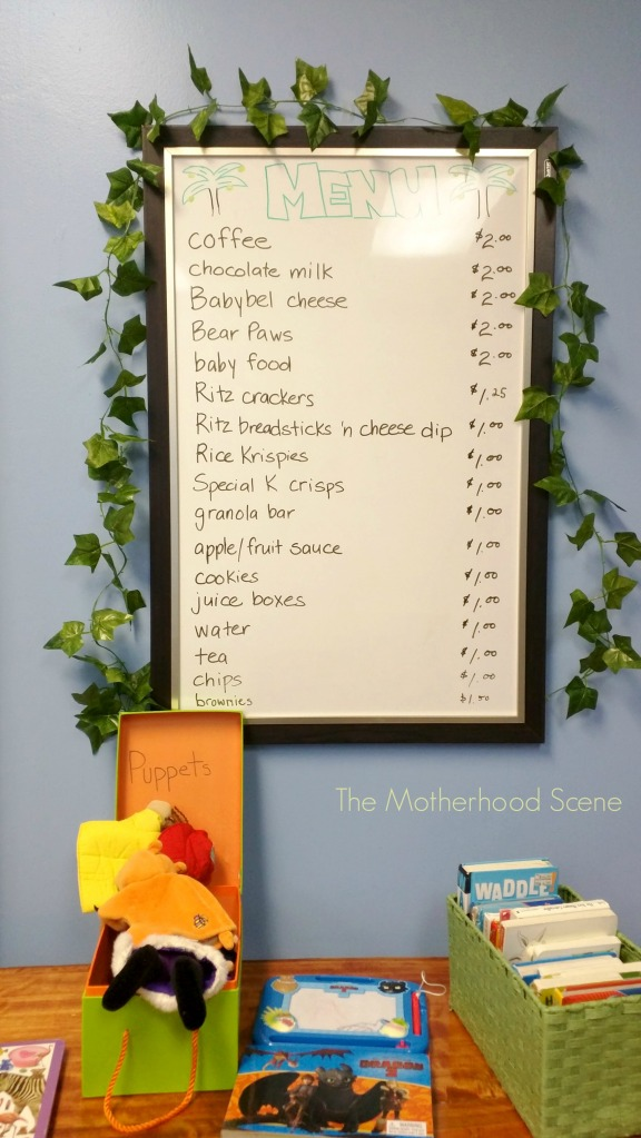 A menu board is posted on the wall inside Monkey Business, listing items available for sale.